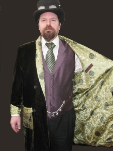Dylan attends Steampunk functions in this knee-length smoking jacket in moss-green velvet with complimentary Chinese silk lining.