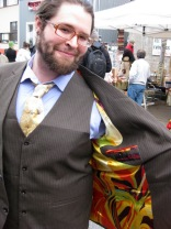 Nick can't hold back his grin when he picked up this neutral-toned pinstripe with pizaszz-satin lining.