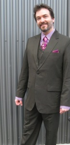Rob dazzles in this magenta-accented grey/olive pinstripe.
