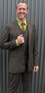 Troy rocks the greens in a sheer olive wool with Japanese silk shirt.