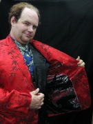 Gabriel in a Chinese silk suit of varying colors.  In case you don't know him...he's sort of an outgoing guy.