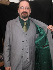 Mark shines his emerald satin lining inside this versatile grey wool suit.