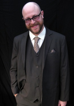 Big smiles are common when clients first try on their custom suits from Ruby Threads Clothiers.
