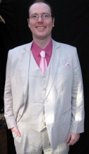 A lot of guys have been ordering this linen/silk material in oatmeal or cream for summer functions. Light and airy - this one accented by some nice Spring colors (real men wear pinks).