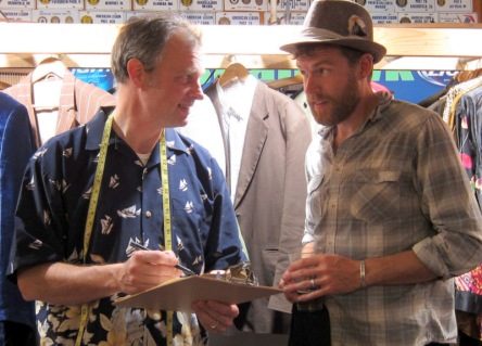 Dan helps Matt with the details on his suit order while he enjoys a beer at a Port Townsend suit-sizing event.
