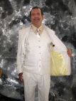 This action-wear special was designed for the Wedding Photographer in August. Airy linen in cream comprises this cool suit. The trousers are silk-lined to the knee with light yellow Vietnamese silk, also found in the jacket's lining. Custom buisness card pocket. Shirt and tie combo by Melsisa.