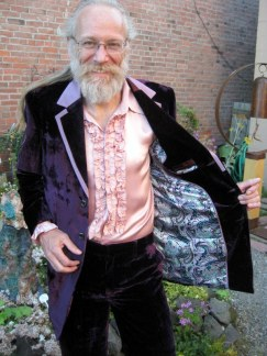 Eric's not shy. He parties down in this Velvet tuxedo with satin trim and complementary lining. Note his frilly shirt and stylistic cuffs. This is one happy suit client! (caution: velvet suits attract touches from strangers)